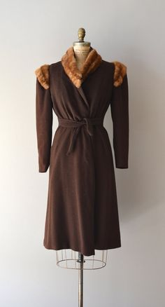 Vintage late 1930s, early 1940s choccolate brown wool wrap-style coat with high mink collar, mink shoulder trim, narrow sleeves, tie belt and golden yellow silk lining.