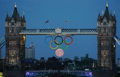 Full moon rising underneath the Olympic rings on Tower Bridge in London   # Pin++ for Pinterest #