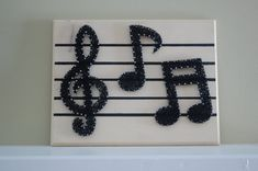 The perfect item for every musician and music lover! This Sheet Music Note String Art is made with sturdy finishing nails, black string, and a