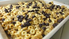 EASY Fun SNACK  ingredients:  6 cups Peanut Butter Cheerios  2 Tablespoons butter  1/3 cup smooth peanut butter  10 ounces (approx. 40 ) regular sized marshmallows  1 cup chocolate chips  Prep a 9×13 pan by greasing it with butter.