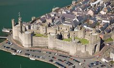 Caernarfon Castle, Wales; it was designed to echo the walls of Constantinople, the imperial power of Rome and the dream castle, 'the fairest that ever man saw', of Welsh myth and legend.