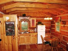 The kitchen at Bear Hug Cabin: • Refrigerator • Electric Range & Oven • Microwave • Mr. Coffee Coffee Maker (basket) • Toaster • Blender • Electric Hand mixer