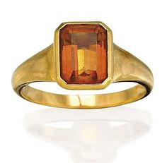 Citrine ring, Bulgari bezel set with a step-cut citrine, mounted in 18ct gold, signed Bvlgari