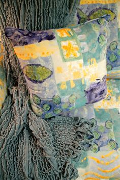 Whimsical fish print gives you lots of colors to work with.  Paint the walls light celadon and it just takes off...