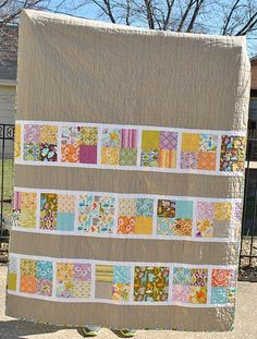 Love this quilt back made with Kate Spain's Central Park fabric. It looks great with this tan neutral, which I would never have thought of.
