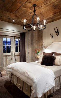 45 Inspiring Rustic Bedroom Design Ideas : 45 Cozy Rustic Bedroom Design Ideas With White Brown Bed Pillow Blanket Wall Chandelier Nightstand Lamp Window Curtain Wooden Door Wardrobe Carpet Floor And Beams