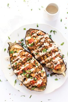 Quinoa Stuffed Eggplant: with mushrooms, tomatoes and a creamy tahini sauce on top - ready in just 30 minutes.