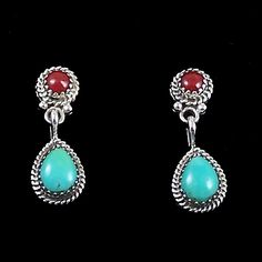 Traditional Navajo drop earrings featuring coral and turquoise in a sterling silver setting. Please be aware that there will be slight variations in the stone coloration from one pair to the next. Dimensions for dangle earrings represent the earring body only (french hook not included in measurement).   All jewelry ships inside a white gift box at no additional charge.   All of our products come with a   30 day - no questions   asked-money back guarantee