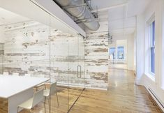 Wall of reclaimed barn wood inside the EDUN Americas Incc. showroom and offices by Spacesmith. Nice texture.