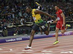 Las fotos de la victoria de Bolt en los 400 metros.