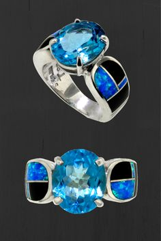 Native American David Rosales Black Beauty Inlaid Ring. This beauty features created opal and black jade inlaid around an incredible blue topaz stone. This ring is completely handmade by Native Americans in Gallup, NM.