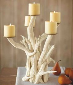 driftwood candle holder - I like to use this idea for inspiration and think this could totally be a DIY project, but in this photo the candles look photo shoped. Driftwood Projects, Driftwood Art, Diy Projects, Driftwood Ideas, Beach Crafts, Diy Crafts, Driftwood Candle Holders, Driftwood Centerpiece, House Essentials