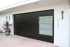Exterior Design, Cool Modern Black Garage Door With Glass Panel With Aluminum Frame Also White Wall Paint Color Also Visit http://www.sdvets.org