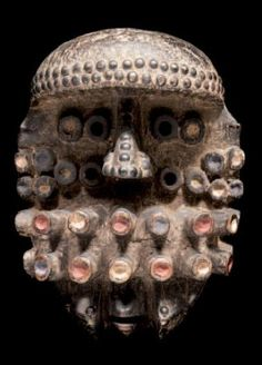 Africa | Mask from the We (Ngere) people of the Ivory Coast | Likely to have been a war (te'e gla) mask | Wood, metal and pigment