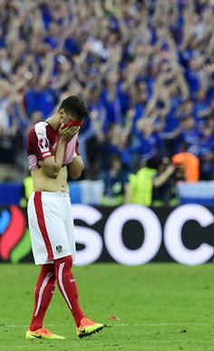 #EURO2016 Austria's defender Aleksandar Dragovic wipes his face after loosing to Iceland 21 in the Euro 2016 group F football match between Iceland and Austria...