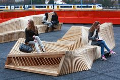 'Reef Benches' by Remy & Veenhuizen.Dutch designers created this organic bench from wooden structures. Placed on the rooftop of a local high school, the wooden bench creates a dune like seating area on a gray urban surroundings.