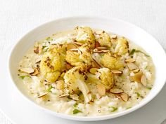 Oven-Roasted Cauliflower is a hearty addition to decadent risotto with fontina cheese and sliced almonds.