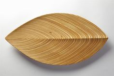 Wooden dish designed by Tapio Wirkkala for Soine et Kni, Finland. 1954. —…