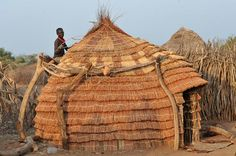Africa | Sights and Sounds.  Toposo tribe, southern sudan, preparing for the rainy season.