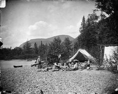 A camping scene / Campement au bord de l'eau | by BiblioArchives / LibraryArchives