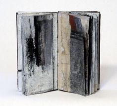 "Reading the Minutes Incorrectly - Linda Welch artist books | 4"" x 2"" x .5"", oil, collage, 22 pages, coptic binding, lead cover. 2011 