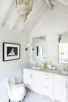 Interesting frame for mirror - marble tile    Before and After: Remodeled Houston Home - Traditional Home