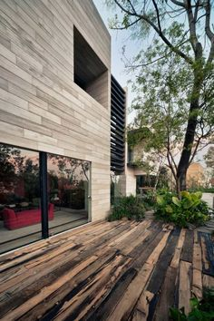 A wood deck features light and dark planks creating a wonderful weathered appearance.