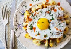 A spicy twist on breakfast for dinner: cheddar jalapeño waffles with a fried egg.