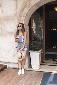 black and white jumpsuit/playsuit, ray-ban sunglasses, straw hat