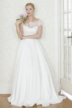 Wedding Dress Inspiration - The Ultimate Bride St. Louis, MO -     Augusta Jones - Bronte - An off the shoulder neckline lace top with a smooth A-line skirt and train. The lace covers the V back with covered buttons and loop detail - Wedding - Dress - Gown - St. Louis