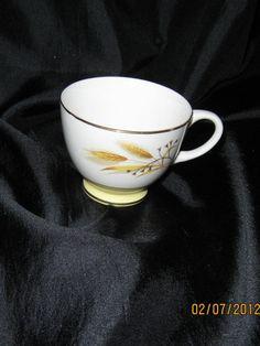 Check out GOLDEN WHEAT PORCELAINWARE Tea Cup, Vintage Mid Century 1950's, Gold Gilded Rim, Homer Laughlin, Duz laundry promotion, Sentimental value on grammastreasure