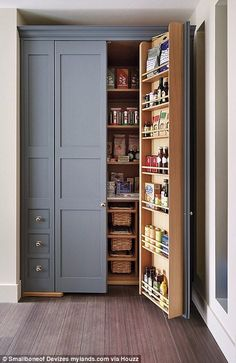 This traditional kitchen features a gorgeous built-in pantry with gray doors and a wooden interior with plenty of shelves and drawers for multipurpose storage Kitchen Pantry Design, Kitchen Pantry Cabinets, Diy Kitchen Storage, New Kitchen, Kitchen Decor, Base Cabinets, Smart Kitchen, Wall Pantry, Country Kitchen