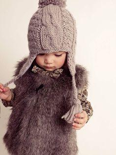 Crochet hat, fur vest. How cute!