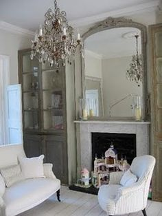 slip covered chairs vintage mirror, grey cabinets and chandelier via @nancy cakes