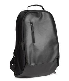 Sleek black backpack with water-repellent surface. #HMMEN