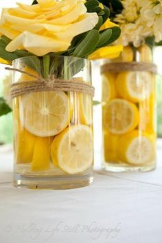 These DIY centerpieces are all sunshine, with buttercup yellow roses and a zing of lemon. Twine wrapped around the vases adds a bit of rustic charm. diy centerpieces simple 25 Stunningly Fresh Wedding Centerpieces With Fruit Summer Table Decorations, Yellow Party Decorations, Summer House Decor, Yellow Party Themes, Italian Party Decorations, Graduation Table Decorations, Home Wedding Decorations, Reception Decorations, Birthday Decorations