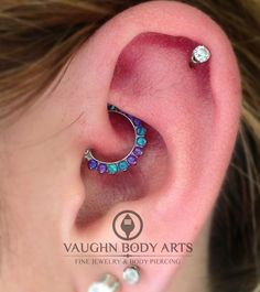 vaughnbodyarts:  We pierced Chloe's daith six months ago and she has been taking great care of it. She stopped in the other day and chose this lovely implant grade titanium clicker from Industrial Strength. Those opals look amazing in her daith. Thank you, Chloe!