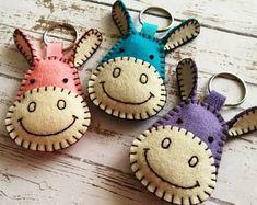 Items similar to Wool Felt Donkey keychain, Blue donkey key chain, Gray donkey keyring, Donkey gift, Pink Donkey bag charm on Etsy Felt Keychain, Keychain Ideas, Tassel Keychain, Felt Bookmark, Moving Gifts, Felt Cat, Felt Decorations, Felt Fabric, Felt Toys