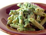 I make this almost every time we get fresh spinach - penne with Spinach sauce -> but I put it over ravioli