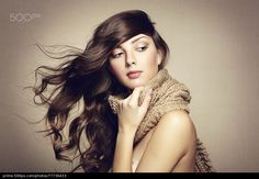 Portrait of a beautiful young woman with scarf - stock photo