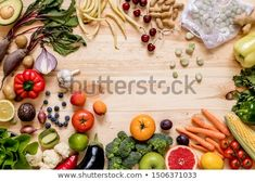 Stock Photo: Modern composition of fresh healthy vegetables and fruits on the wooden table in the kitchen. Healthy detox and balance diet. Healthy Detox, Healthy Vegetables, Balanced Diet, Wooden Tables, Top View, Zero Waste, Decoration, Bamboo Cutting Board, Vegan Vegetarian