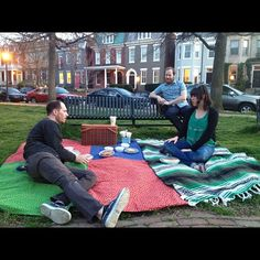 customers using our picnic baskets in the park. Photo by Christine