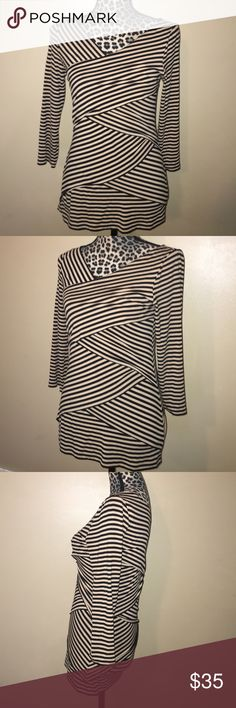 Vince Camuto Layered Stripe Top Size small, 95% rayon 5% spandex, in good condition. Beautiful Top! Vince Camuto Tops Blouses