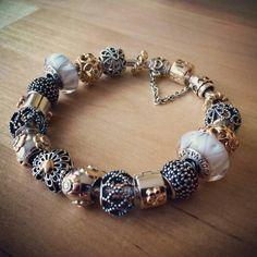 Pandora bracelet in gold, silver and white