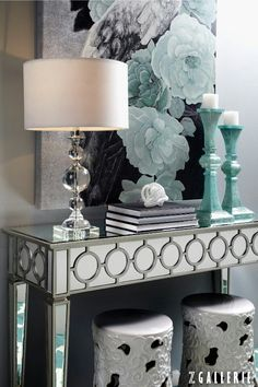 Love the sea green blue water colors used in this classy sophisticated lady like entryway! The painting is stunning!
