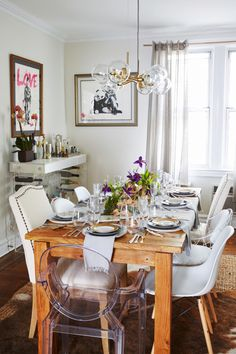 """As Helena says, """"Mixing and matching speaks to us as a couple. We don't like to take ourselves too seriously."""" With this in mind, Matthew and Helena chose most items in the dining room to feel like a hodgepodge. <br> Matthew chimes in: """"By mixing and matching everything on the table scape, from flatware to plates, we were able to create the cool-adult dining room without it feeling stuffy or too cliché when they have family or guests over."""""""