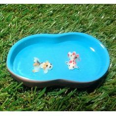 Mini Goldfish in the Pond. www.teeliesfairygarden.com . . . The fairies will love to see cute goldfish in the pond! This is a brilliant accessory in any corner of your fairy garden. #fairyfish