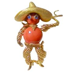 Whimsical Sapphire Coral Gold Bandito Brooch circa 1950s | From a unique collection of vintage brooches at https://www.1stdibs.com/jewelry/brooches/brooches/