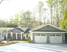 Pretty Garage Doors go a long way for curb appeal!  And I like the paint colors too, and the fact that these pretty garage doors are the accent color instead of the house color