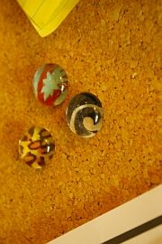 we call these dragon tears - dollar tree has bags of them all colours ..magazines and maps are neat too  http://creativeoutletdesigns.blogspot.com/2007/10/diy-fridge-magnets-and-pushpins.html